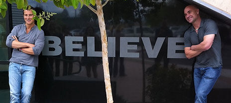 Andre Agassi and Bear Grylls with a Believe sign