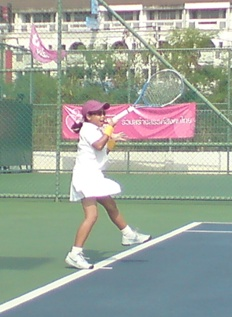 Poonky hitting a forehand
