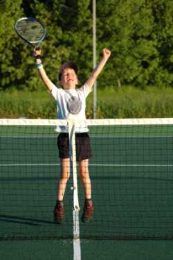 Tennis kid winning the match